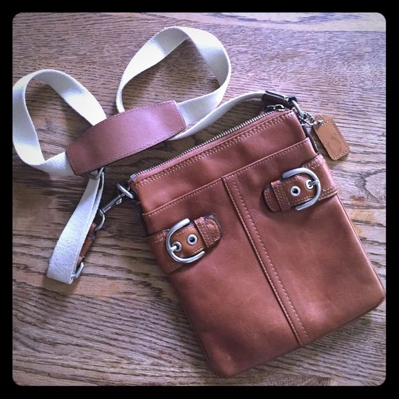 Coach crossbody purse Brown leather. Great outside condition...the only marks are on the inside (shown in photo #4) and on the small Coach tag. Coach Bags Crossbody Bags