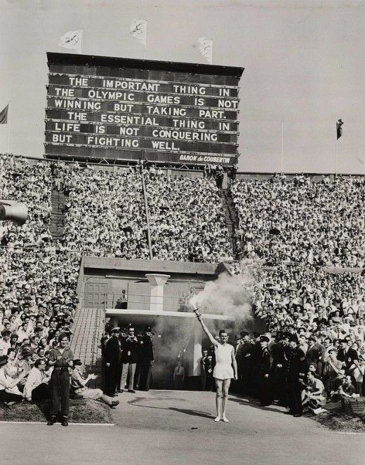 The opening ceremony of the 1948 Olympics in London. Nicknamed the Austerity Games because England was still under rationing and much of London had yet to be rebuilt after the blitz. Many countries brought in their own food for their athletes, including the USA which delivered bread, chocolate and other delicacies daily.