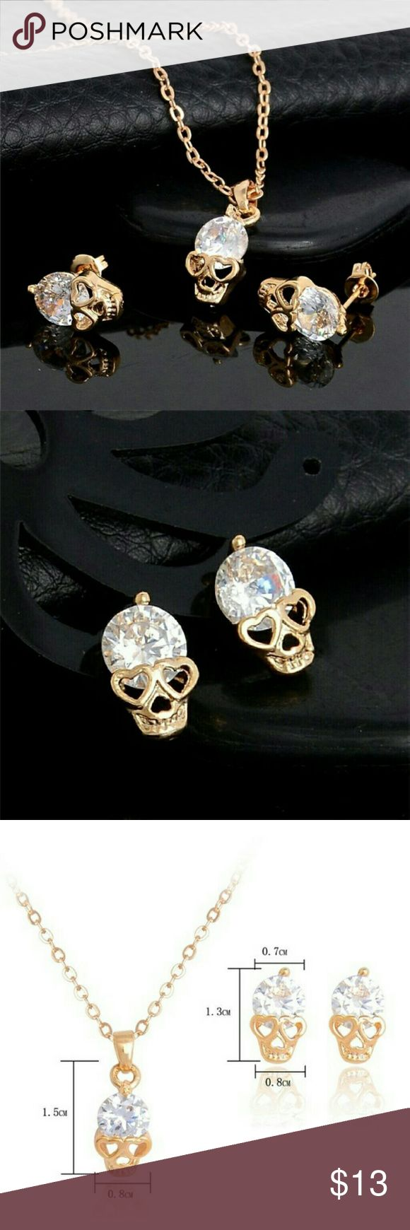 3 Piece Set - 18K Gold & Cubic Zirconia Skulls If you love skulls, these are a must have!  Statement pieces that show personality and at the same time, are pretty and feminine!  1 Set of Earrings and 1 Necklace - a 3 Piece Set!  Product Details: ? The skulls eyes are ?hearts? - super cute! ? Skulls are 18K Gold Filled ? Diamonds are Cubic Zirconia  Q:? 18K Gold Filled? What does that mean? A: A layer of 18K gold is bonded under heat and pressure to the surface of a base metal underneath…