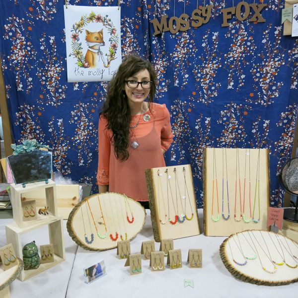Jewelry display at a craft fair. The wood blocks and slices make a nice neutral background