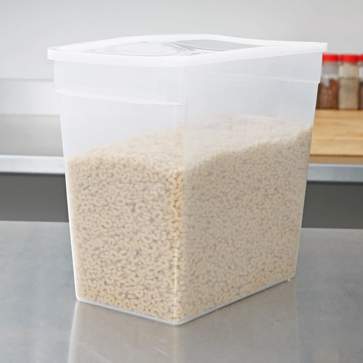Store foods with this space-saving Carlisle ST162930 StorPlus 18 qt. translucent rectangular storage container! The rectangular shape makes this polypropylene container easy to stack and store on shelves or in coolers. Its large 18 qt. capacity makes it ideal for keeping large quantities of flour, pasta, and rice, as well as whole fruits and vegetables.<br><br>The translucent color allows for easy product identification. The molded-in graduations show capacity, which aids in takin...