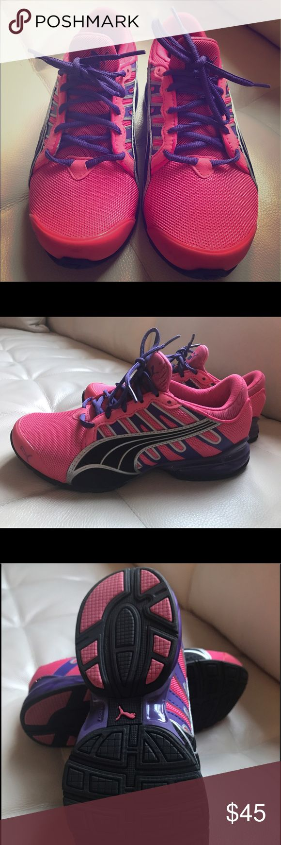Brand New Puma Sneakers!! Brand New. Never worn but no box. Ladies size 6.5 running sneaker. Pink and purple Puma Shoes Sneakers