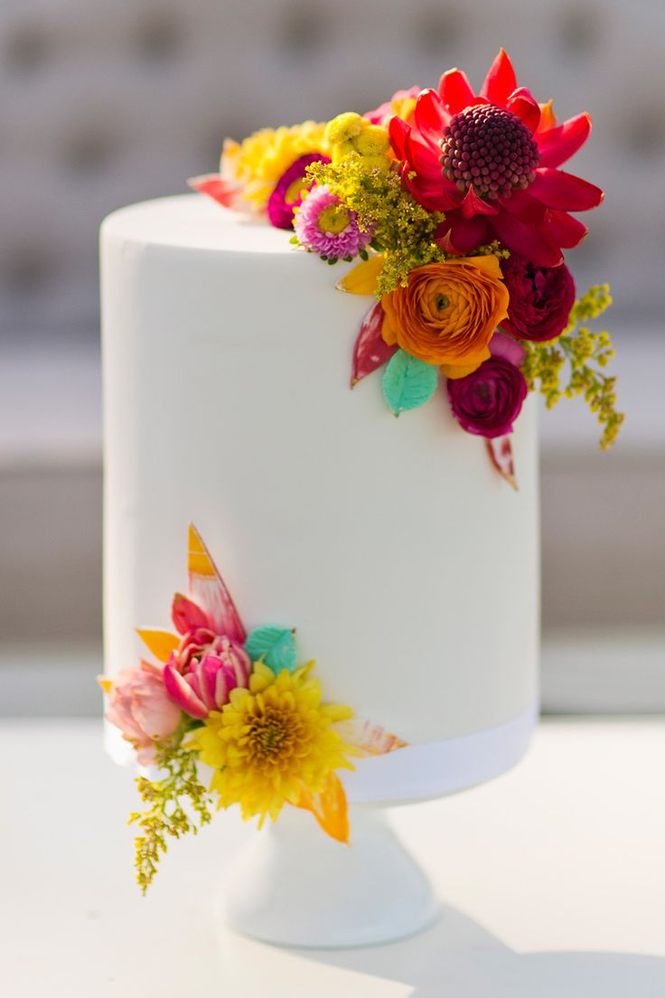 Bright summer fondant wedding cake with fresh flowers and painted leaves | Lyndal Carmichael Photography