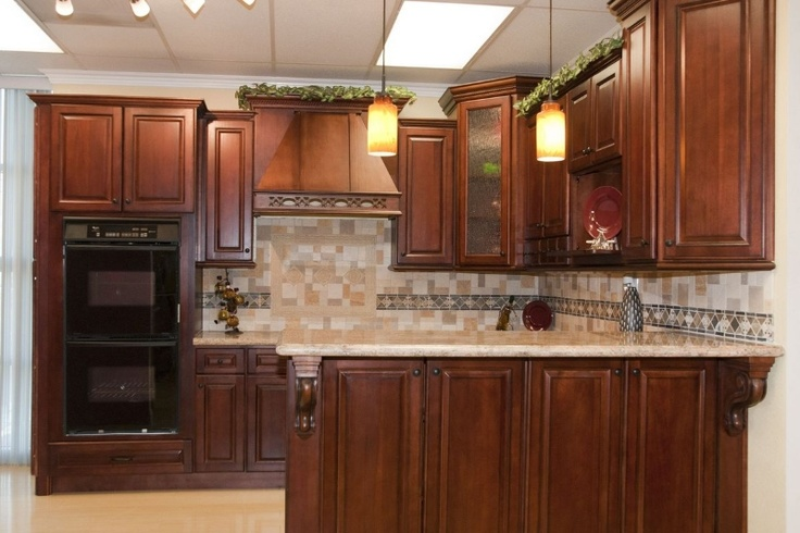 Light Floor And Counter Tops With Dark Cherry Wood