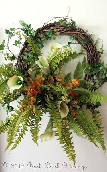 Grapevine wreath w/lots of greenery, flowers