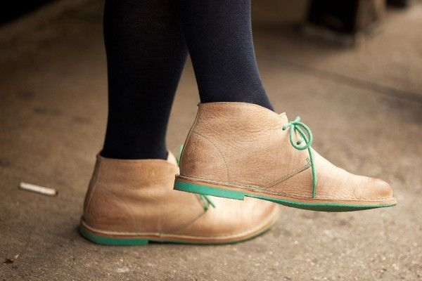 green soles, green laces
