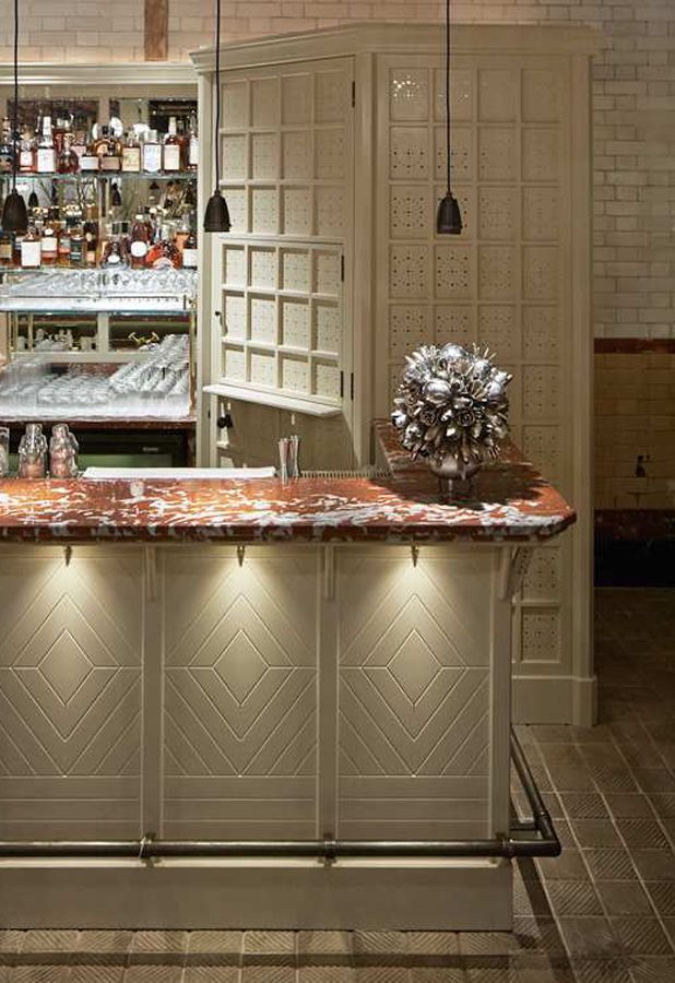 Chiltern Firehouse Restaurant and Hotel, London, design by Studio KO (2014). Note the red marble top.