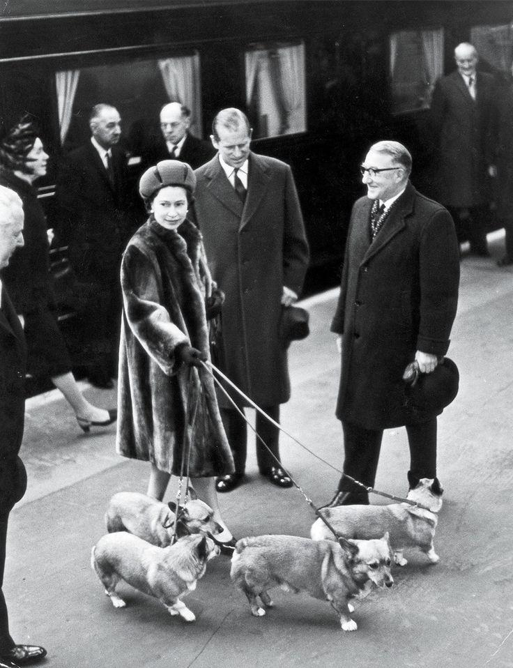 vanityfair: Queen Elizabeth and the Duke of Edinburgh with the corgis, Liverpool Street Station, London, 1968