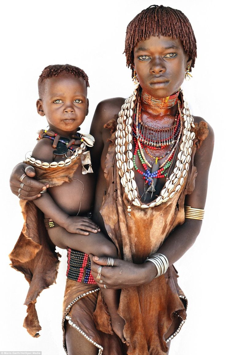 A young girl and her baby from the Hamar tribe. When a male relative wants to marry, a Hamar girl faces being beaten to create a 'blood debt' to remind him to help her if she goes through tough times in the future