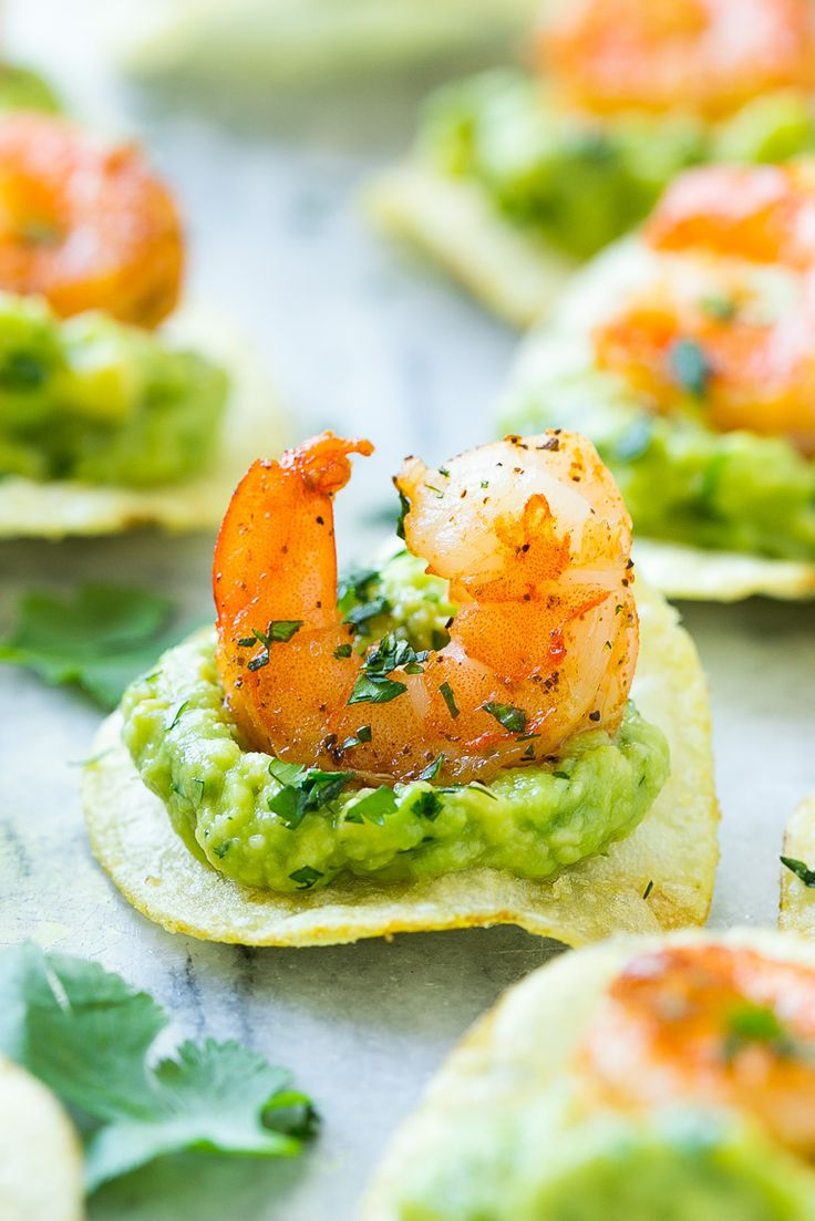 This recipe for Mexican shrimp bites is seared shrimp and guacamole layered onto individual potato chips. A super easy appetizer!