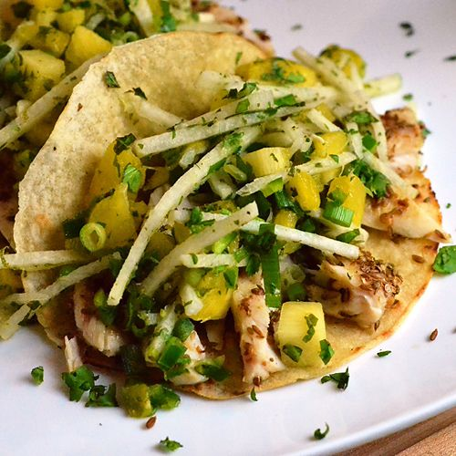 Fish Tacos with Pineapple Jicama Slaw  Mahi mahi is grilled with a coriander and cumin seed crust, which provides the perfect balance to the light and crunchy pineapple jicama slaw, and the whole meal is ready in just 40 minutes!