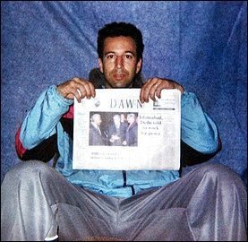This undated photo shows Wall Street Journal reporter Daniel Pearl at an undisclosed location with a copy of the English language newspaper Dawn. According to the Wall Street Journal Pearl has been kidnapped by the previously unknown group National Movement for the Restoration of Pakistani Sovereignty who are demanding the release of suspected Pakistani terrorists in US custody at the Guantanamo Bay Naval Station in Cuba.