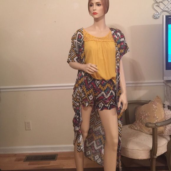 NWT Aztec Outfit Whole outfit for sale. New with tags never been worn. Shaw is a Small. Mustard shirt is a Large but can fit it's small (like on mannequin) Shorts are size medium. Comment if you have any questions :) Other