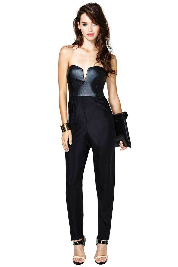 Available In Black Faux Leather Jumpsuit V Neck Zipper Back Skinny Leg 97% Polyester 3% Spandex Made in USA.