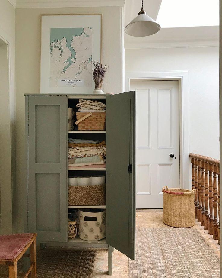 Modern Farmhouse Armoire In Hallway With Storage Farmhouse Storage Ideas In Neutral Hallway Home Decor Home Interior