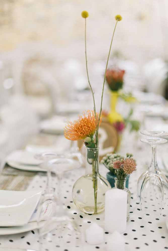 polka dot table runner & vibrant floral centerpieces