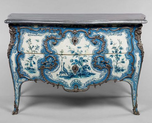 Madame de Mailly's Commode, ca 1742. Madame de M. - one of Louis XV's mistresses - was the proud owner of this beautiful commode by Matthew Criaerd. The style is an imitation of the oriental lacquer which was quite fashionable at the time; though the bright blue and white is more Versailles than the Far East. This is quite rare since most furnitures of this time would have golden carvings rather than silver - especially when the material already had a golden shine to it. / This is Versailles