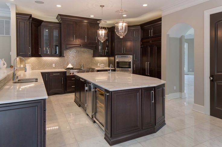 Sleek kitchen with large island and glossy finishes. #kitchens #kitchendesigns homechanneltv.com