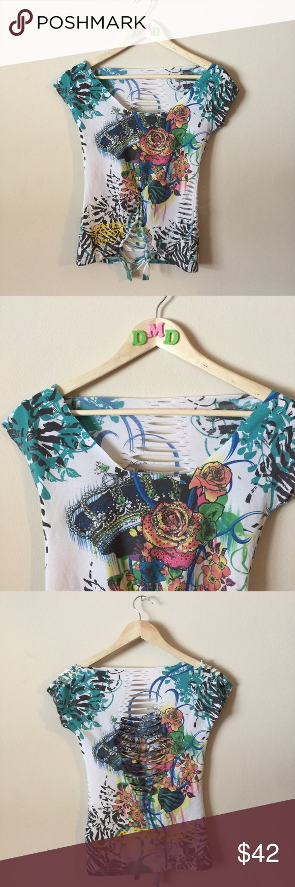 ✂️ CUSTOM • Ed Hardy shredded cut up shirt • CUSTOM SHREDDED CUT UP & WOVEN / BRAIDED ED HARDY SHIRT • Very colorful and bright flower designs with studs, rhinestones, bling embellishment • Has custom cuts throughout; somewhat low cut neckline  • SIZE: SMALL  #edhardy #chrstianaudigier #tattoo #buckle #bke #rhinestone #designer #sliced #shredded #revamped #restyled #lowcut #unique Ed Hardy Tops Tees - Short Sleeve