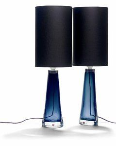 A pair of table lamps of steel blue glass cased by clear glass. Black fabric shades. Made by Orrefors, c,1950.jpg