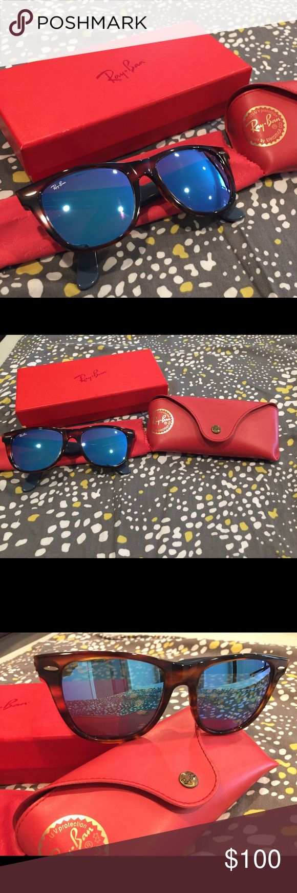 Mirrored Wayfarer Ray Bans 😎 100% authentic Ray-Ban. Frame: tortoise. Lens: blue mirror. Very cute & stylish. Comes with box, case & cleaning cloth. No scratches. Only worn 1-2 times. Smoke free home 😎 Ray-Ban Accessories Sunglasses