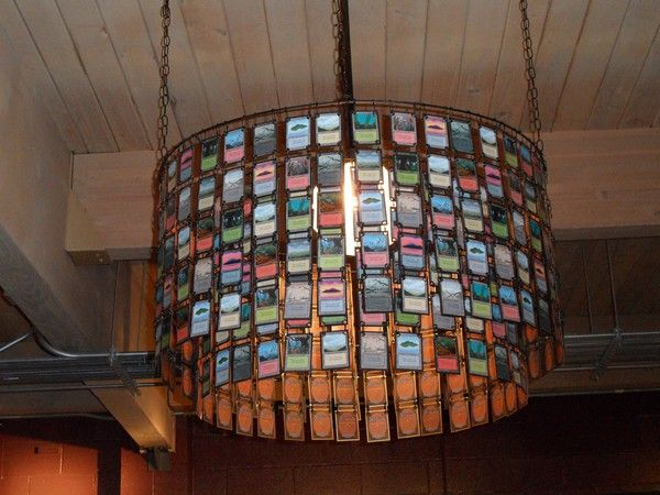 For all my nerd friends out there :) These are magic the gathering old basic land cards made into a chandelier. This was found in CardKingdom.com's store in Seattle amy_