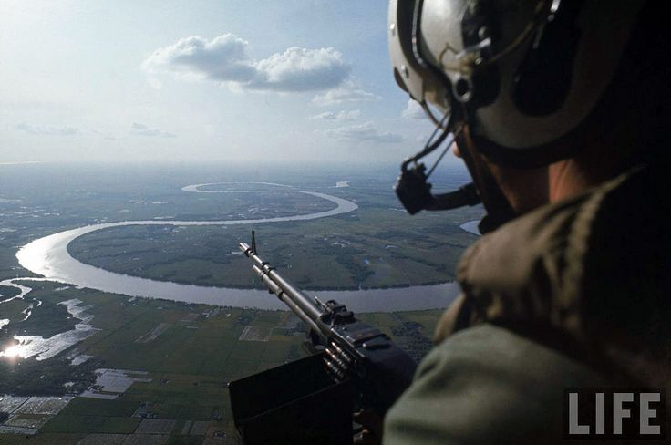 Machine gunner scanning for hostiles while his helicopter is on patrol over the Mekong  delta Photo by Larry Burrows    john Kenny, linhsuzu and 3 more people faved this