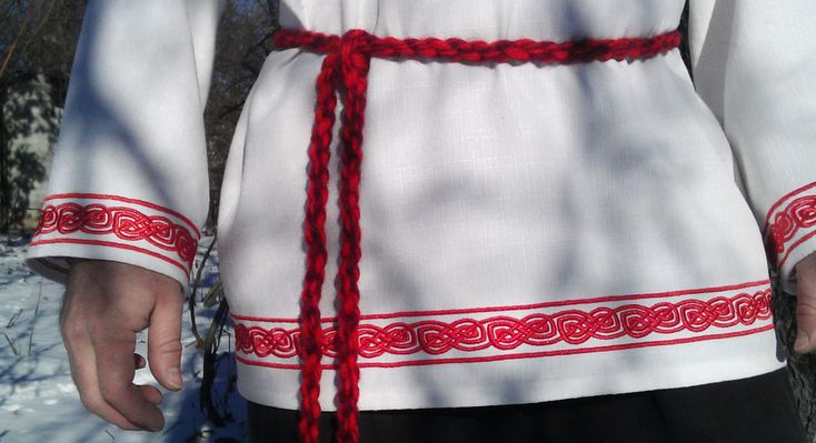 Russian mens shirt with stand-up collar embellished with stitch. Sewn underarm inserts-gussets. Machine embroidery. At the top are the sacred sign - Svarogs square (star of Virgin). At the center of the displayed Thunderous wheel - the sign of Perun, the six-pointed cross in a circle. It is a symbol of courage and military prowess. One of the magical characters of Russian squads. It can be found on helmets, plate armor. He also embroidered on mens shirts. Fringe the wheel of fire eagles…