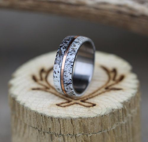 Men's elk antler wedding band with rose gold inlay.