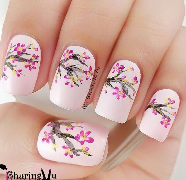 Beautiful cherry blossom spring nail art design. Spring is the time when cherry blossoms come about and what better way than to recreate them on your own nails.