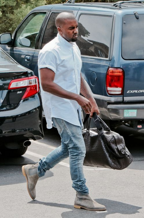http://chicerman.com  billy-george:  Kanye west in faded blue jeans white shirt and grey chelsea boots.  #streetstyleformen