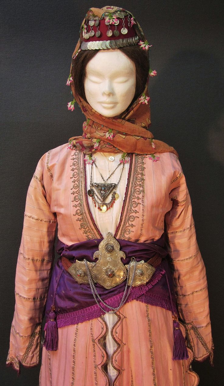 Close-up of a traditional festive costume from the Konya province.  Late-Ottoman urban fashion, end of 19th century.  With garments and jewelry from 1875-1900, or earlier.  (Kavak Costume Collection - Antwerpen/Belgium).