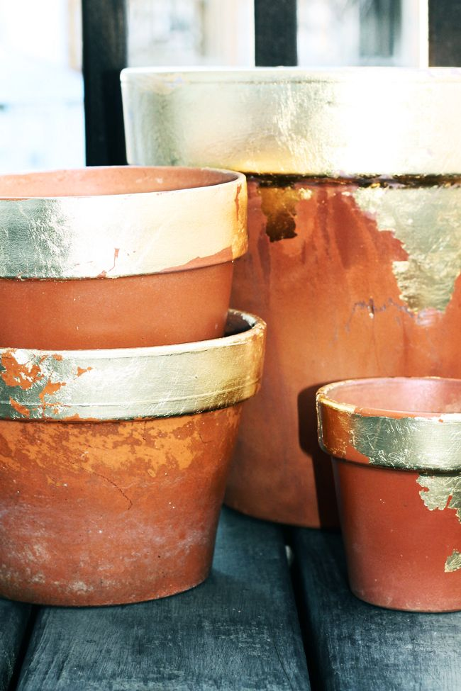 Gold leaf old terracotta pots for a rustic-meets-glam look