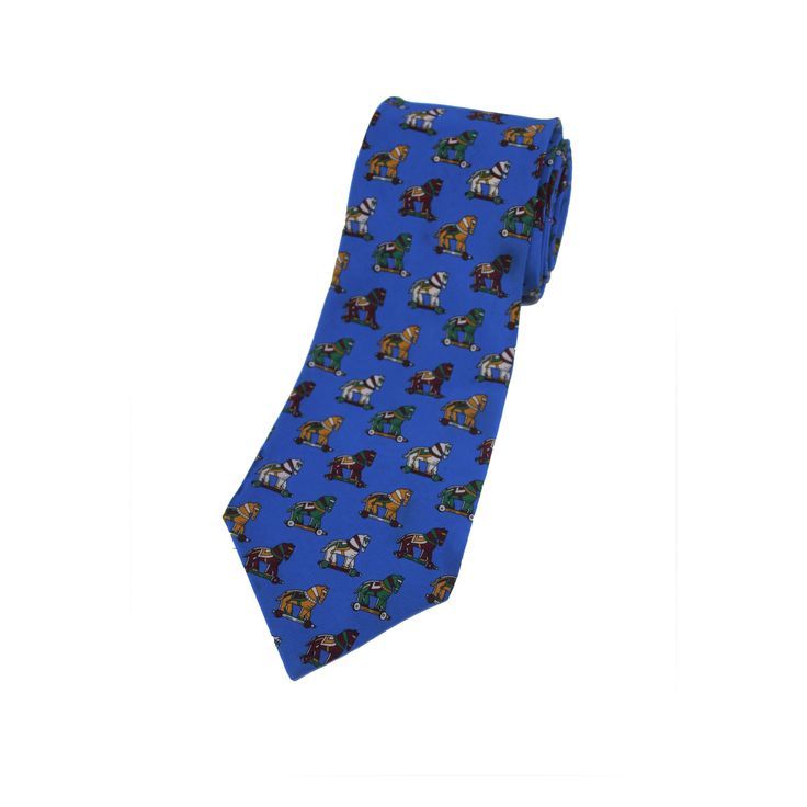A distinguished design by Play boy Boutique vintage silk tie with wooden horse pattern. made in France, 100% silk.