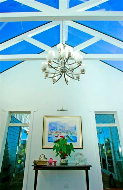 A glass atrium in the foyer creates a stunnng welcome for guests.