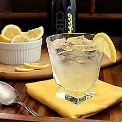 Sparkling Lemon Ginger Cooler – Lemon and Ginger simple syrup are combined with sparkling wine for a light, summer cocktail.