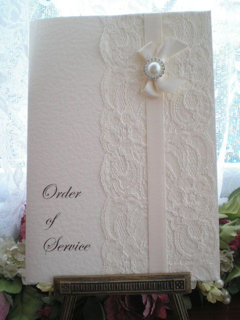 K0020 Chanel Ivory Lace Satin Ribbon Order of Service, Available from: www.vintagelaceweddingcards.co.uk