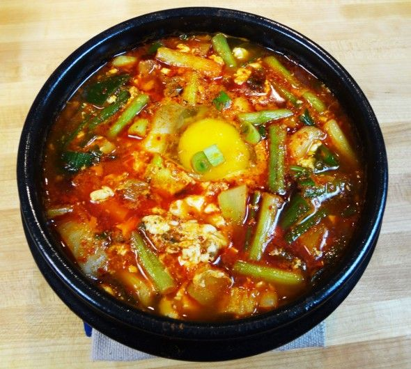 Soondubu Jjigae (Soft Tofu Stew) Recipe from Maangchi.com. Her recipes and videos are easy to follow. I made korean dumplings and added into stew instead of the mixed seafood bc that's what I like to order from the restaurant. Korean food is one of my favs
