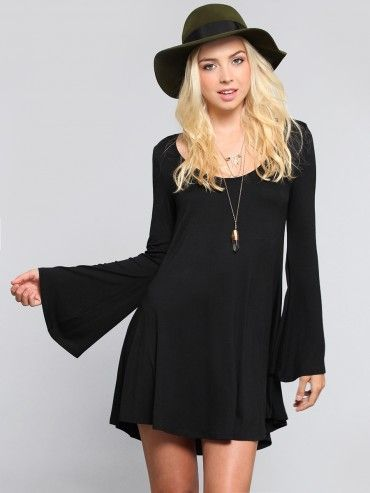 Super soft jersey dress featuring long bell sleeves and a flowy silhouette that flares slightly away from the body