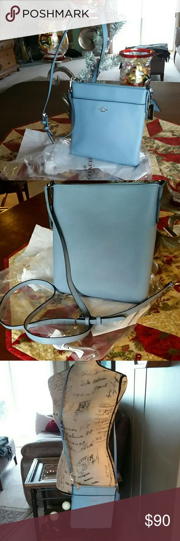 """Coach Small Crossbody Courier Really cute authentic Coach pebble leather crossbody bag. Soft muted blue. One inside pocket. 8X8.5"""" with 47"""" adjustable  strap and silver hard ware. Two Coach tags. Brand new never used. To small for me. Coach Bags Crossbody Bags"""
