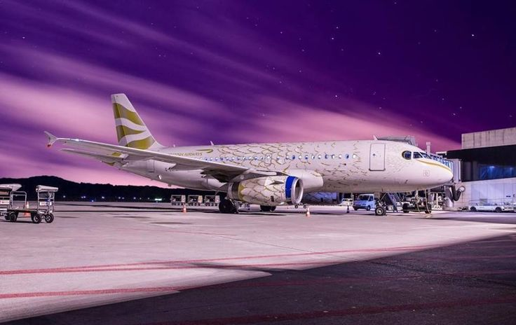 """British Airways Airbus A319-131 G-EUPH in """"Olympic Dove"""" livery at Zürich-Kloten. Designed by Pascal Anson, to celebrate the London 2012 Olympic Games, this special livery adorned nine BA aircraft. (Photo: Cirill Schnelli)"""