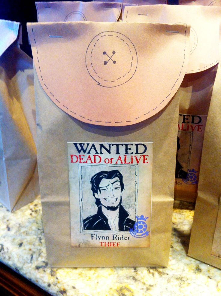 Paper bag satchel for Tangled party favors -Ideas to theme a Tangled outdoor movie night from Southern Outdoor Cinema of Atlanta.
