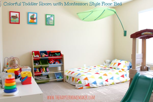 Montessori-inspired bedroom - floor bed, low shelves (Think IKEA expedit), and independence-encouraging activity spaces.