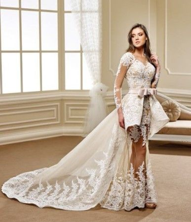 Fancy A haute couture wedding gown with sheer long sleeves The peplum style wedding gown has