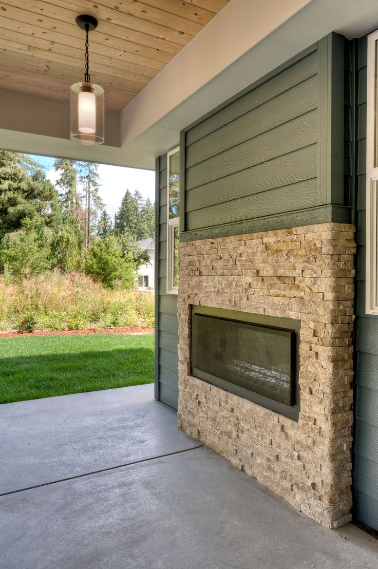 Outdoor living design ideas amp inspiration gallery install it direct - Covered Patio With Outdoor Gas Fireplace And Stylish Pendant Light