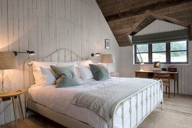 Cabin Bedroom with Neutral Scheme  - Bedroom Ideas - HOUSE. Metal bed frame in a room otherwise furnished with wooden furniture at Farmhouse by Soho House