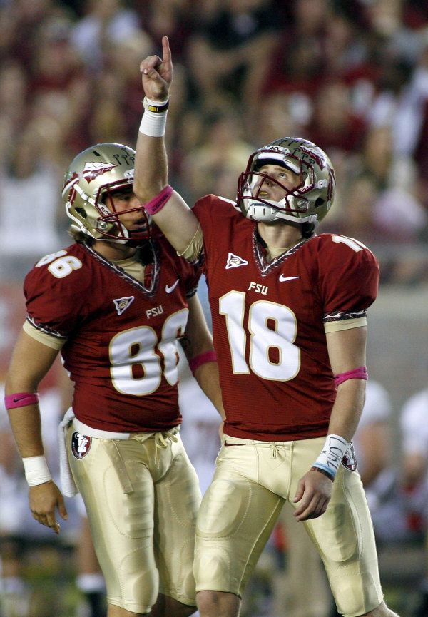 Florida State holder Chris Revell (86) watches as kicker Dustin Hopkins (18) celebrates after making a 51-yard field goal at the end of the second quarter. (AP Photo/Phil Sears)