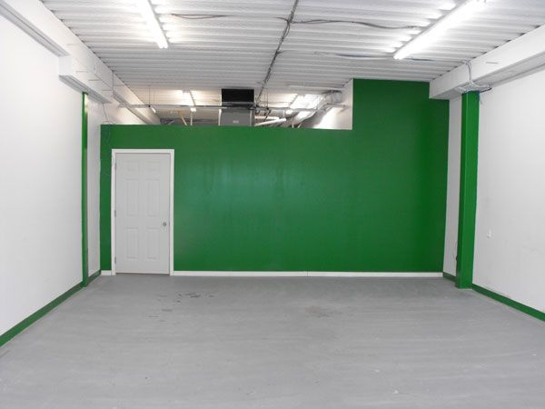 Current view when you enter the store. Of course the green will be painted over! That wall remains, receiving and stock room are behind the wall.
