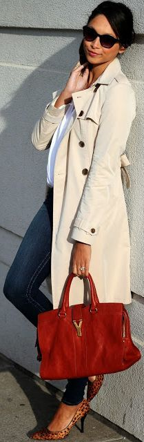 Jeans with a winter white jacket and a red purse. Classic for sure.