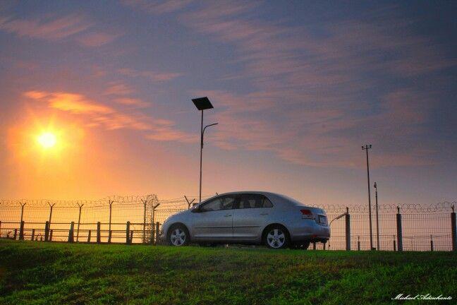 A car with the sun
